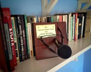 Michael keeps his Award next to his books by Boris Vian