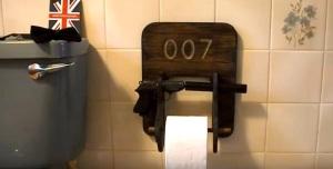 John Ward toilet accessory with gun, silencer and loo roll