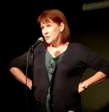 Trish Bertram on stage at the Amused Moose showcase