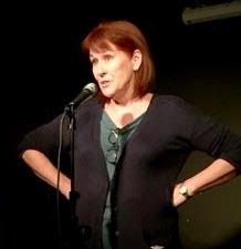 Trish Bertram on stage at the Amused Moose showcase