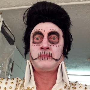 Frank Sanazi/Pete Cunningham as Elvis Corpsely
