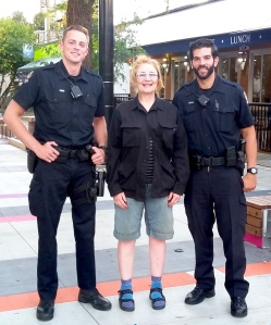 Anna Smith with two cops in Vancouver