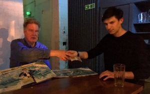 The Iceman and (I presume) Laurence shake on the art deal.